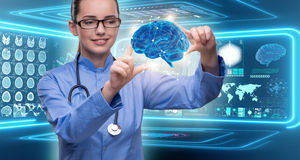 The female doctor with the brain in medical concept Royalty Free Stock Photo