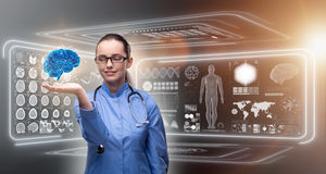 The female doctor with the brain in medical concept Stock Photo