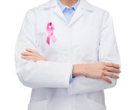 Female doctor with breast cancer awareness ribbon Royalty Free Stock Photo