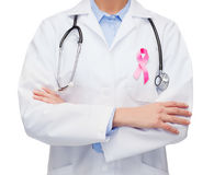 Female doctor with breast cancer awareness ribbon Stock Photo