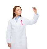 Female doctor with breast cancer awareness ribbon Stock Photography