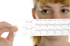 Female doctor with cardiogram. Over white background Stock Image