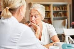 Free Female Doctor Cares In Depressive Elderly Woman Stock Photos - 161155513