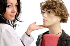 Female doctor caressing a male Stock Images