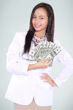 Female doctor carrying a lot of money dollars Royalty Free Stock Photo