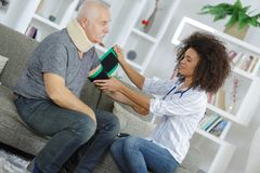 Female doctor checking blood pressure senior patient Stock Photos