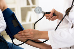 Female doctor checking blood pressure of senior woman, closeup Royalty Free Stock Photography
