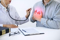Female doctor checking heart beat of patient and recommend treat. Ment methods and how to use medicine stock photography