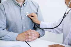 Female doctor checking heart beat of patient and recommend treat. Ment methods and how to use medicine stock images