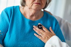 Female Doctor Checking Senior Ladys Heart With Stethoscope royalty free stock images