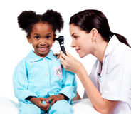 Female doctor checking her patient's ears Royalty Free Stock Photography