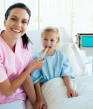 Female doctor checking her patient's throat Royalty Free Stock Photography