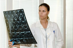 Female doctor checking an MR. Exposure royalty free stock photography