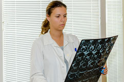 Female doctor checking an MR. Exposure royalty free stock images