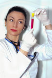 Female doctor checking the reaction in test tube Royalty Free Stock Photo