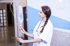Female doctor checking a saline drip stock photos