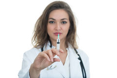 Female doctor checking a syringe isolated on white background Royalty Free Stock Image