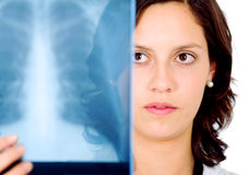 Female doctor checking an xray Royalty Free Stock Photos