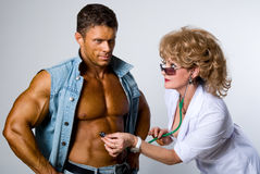 Female doctor checks a patient Royalty Free Stock Photo