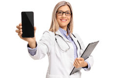 Female doctor with a clipboard showing a phone. Isolated on white background stock image