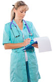 Female doctor with clipboard writing isolated Stock Photos