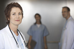 Female Doctor With Colleagues In Elevator Royalty Free Stock Photo