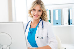 Female doctor with computer Royalty Free Stock Image