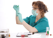 Female doctor conducting tests in a laboratory Stock Photo