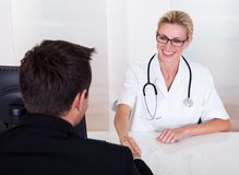Female doctor consulting with a patient Stock Image