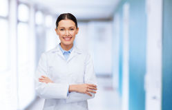 Female doctor with crossed arms at hospital Stock Images