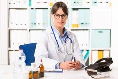 Female doctor at desk Stock Photo