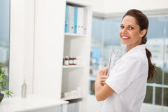 Female doctor with digital tablet in medical office Royalty Free Stock Photos