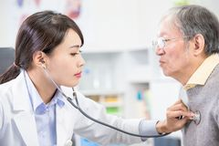 Female doctor do heartbeat check stock image