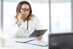Female Doctor on the Doctors Office Royalty Free Stock Photos