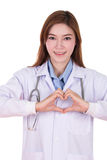 Female doctor doing a heart with her hands Royalty Free Stock Photography
