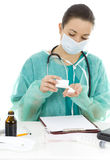 Female doctor with drug an clipboard at office Royalty Free Stock Photos