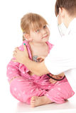 Female doctor exam little girl Royalty Free Stock Photography