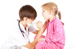 Female doctor exam little girl Royalty Free Stock Images