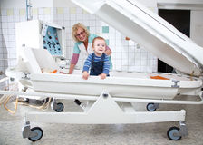Female doctor examines little boy in pressure chamber. In hospital cabinet Royalty Free Stock Photos