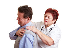 Female doctor examing back pain stock photography