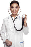 Female doctor examing with stethoscope. Cheerful smiling female doctor examing with stethoscope, isolated over white background Royalty Free Stock Photo