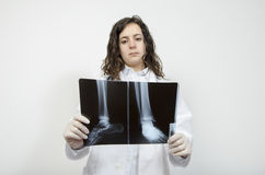 Female doctor examining accurately a foot  x-ray. Stock Images
