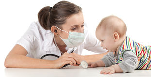 Female doctor examining baby Stock Images