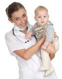 Female doctor examining baby boy Royalty Free Stock Photos