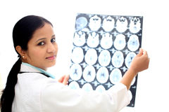 Female doctor examining a brain tomography scan Stock Photo