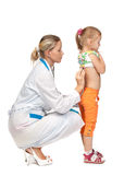 Female  doctor examining a child Royalty Free Stock Photography