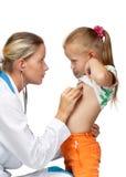Female doctor examining a child stock photo