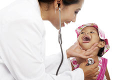 Female doctor examining child Stock Photo