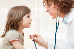 Female doctor examining child Stock Images
