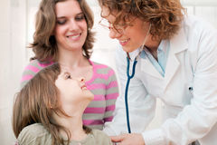 Female doctor examining child - family Royalty Free Stock Photo